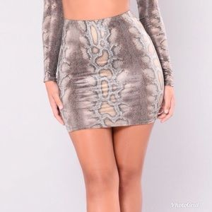 Skin tight snake skin. Only worn once.